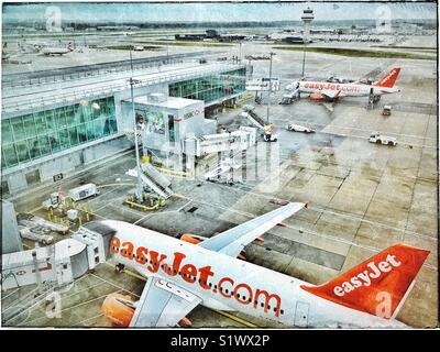 An aerial view of the arrival/departure gates (airside) @ London Gatwick Airport, England. Clearly visible are 2 - Stock Photo