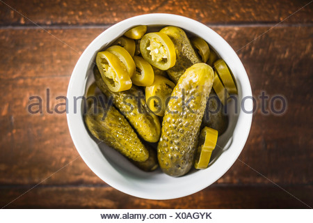 Bowl of pickles and chili pepper slices - Stock Photo