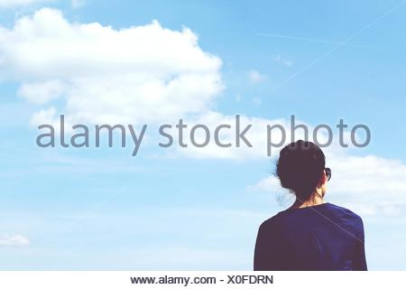 Rear View Of Woman Against Sky - Stock Photo