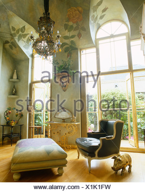 French Style Armchair And Ottoman In Living Room With High, Rose Painted  Ceiling And French