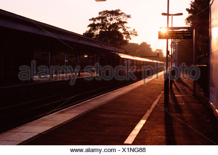 Railroad station at sunrise - Stock Photo