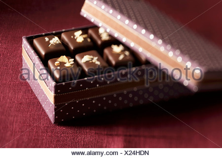 Nougat chocolates in gift box - Stock Photo