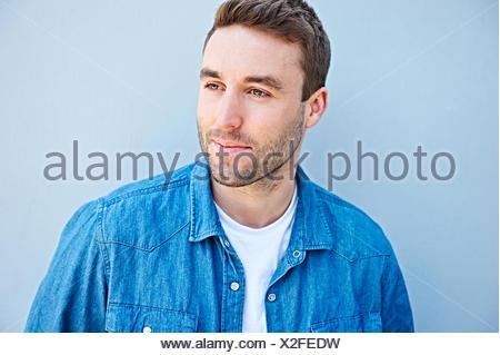 Close up of man in denim shirt - Stock Photo