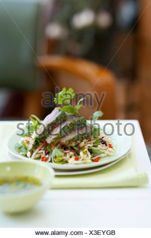 Marinated tuna with coriander on sprout salad - Stock Photo