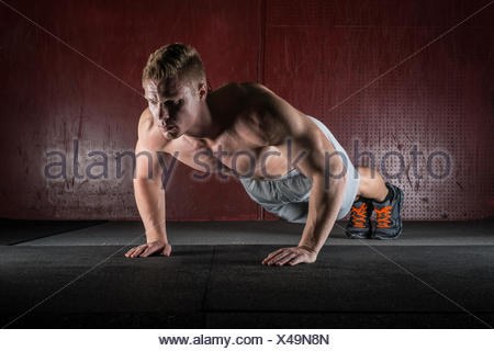 Man doing push-ups - Stock Photo