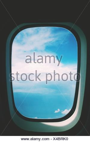 Scenic View Of Cloudscape Seen Through Airplane Window - Stock Photo