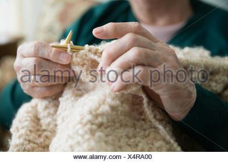 Close up senior woman knitting - Stock Photo