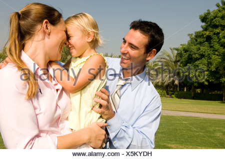 A mother and father with their young daughter - Stock Photo