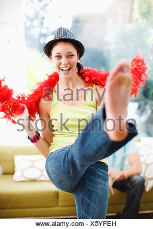 Woman dancing in hat and feather boa - Stock Photo
