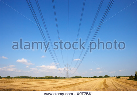 Electricity pylon and lines in countryside - Stock Photo
