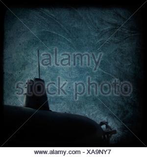 A dark submarine under water - Stock Photo