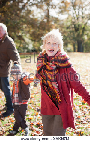 Grandparents playing in park with grandson - Stock Photo