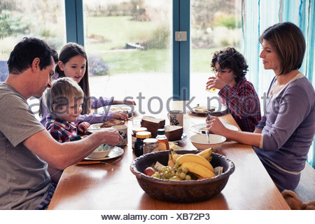 Family having dinner together at table - Stock Photo