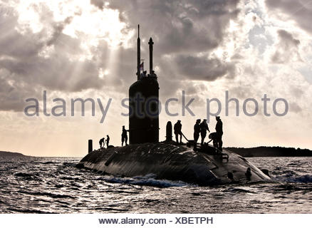Nuclear Submarine HMS Talent and crew, backlit in Egypt - Stock Photo