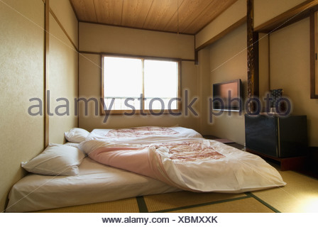 Traditional Japanese Bedroom With Tatami Floor And Futon Beds Stock