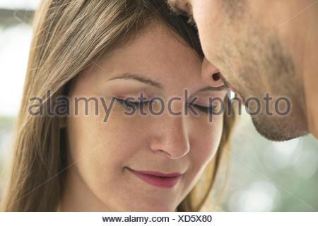 Couple nuzzling, close-up - Stock Photo
