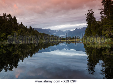 Mt. Tasman and Mt. Cook, Aoraki, reflection in Lake Matheson, Mt. Cook National Park, Westland National Park, Southern Alps - Stock Photo