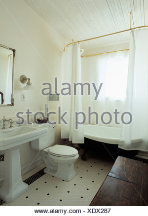 ... White Shower Curtains On Freestanding Bath In Traditional White Bathroom  With White Pedestal Basin And Black