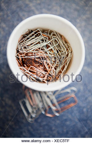 Close-up of a container filled with paper clips - Stock Photo