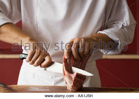 Schneiden von Fleisch Koch - Stockfoto