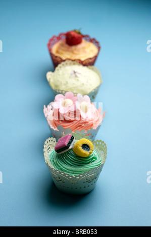 Vier Cupcakes - Stockfoto