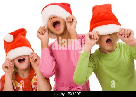 Foto der happy Friends in Santa Caps Spaß zusammen - Stockfoto