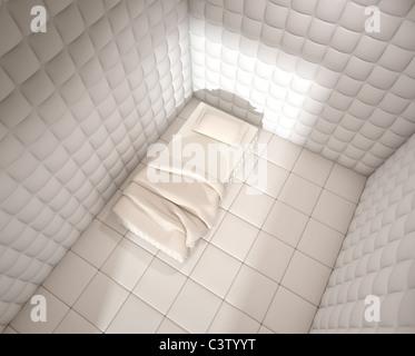 psychiatrischen Klinik gepolstert Zimmer mit einem Einzelbett von oben gesehen - Stockfoto
