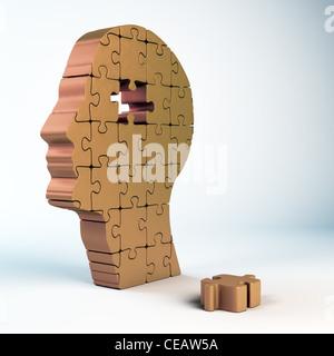 Einen männlichen Kopf Build aus Puzzle-Teile - Stockfoto