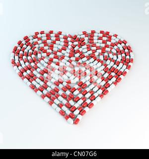 Rote und weiße Kapseln bilden eine Herzform - Kardiologie-Konzept - Stockfoto