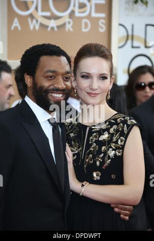Los Angeles, USA. 11. Januar 2014. Britischer Schauspieler Chiwetel Ejiofor und Partner Sari Mercer teilnehmen 71st - Stockfoto