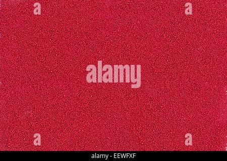 Hintergrund der winzige rote metallische Kugeln - Stockfoto