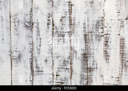 Verwitterte Holz Hintergrund: distressed Farbe auf einem alten Holzzaun - Stockfoto