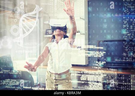 Abbildung: DNA gegen Mädchen mit Virtual reality Simulator zu Hause - Stockfoto