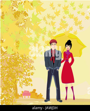 Couple walking in autumn day Banque D'Images