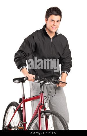 Un giovane ragazzo che posano su una bici Foto Stock